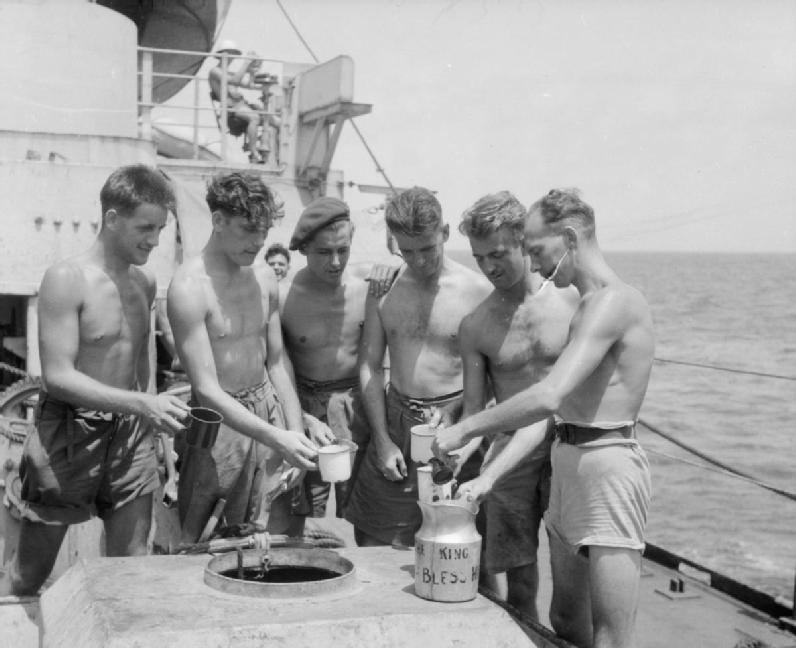 The British Reoccupation of Hong Kong, 1945 Men of the 3rd Commando Brigade receive their rum ration aboard Landing Ship Tank LST 304 - Photo: Wikicommons
