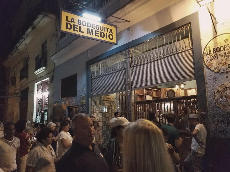 La Bodeguita Del Medio is loaded with character and visitors. :) Photo by Paul Senft.