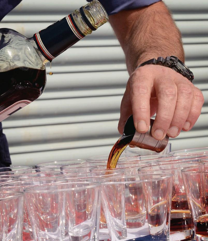 Pouring Tots of Rum - Photo: Flickr / Defence Images