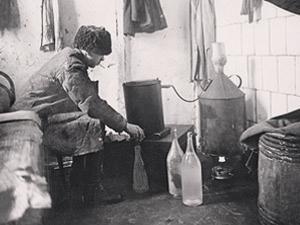 Distilling Samogon in 1920s. Source: Wikimedia