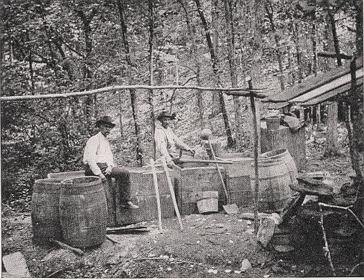 Revenue Men at the site of a Moonshine distillery in Kentucky, 1911 or before. Source: Wikimedia