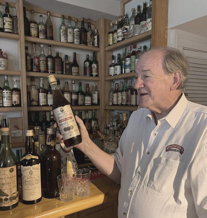 Stephen and a tiny fraction of his Rum collection. Photo credit: Gayle Seale